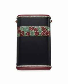 AN ART DECO ONYX, CORAL AND DIAMOND CIGARETTE CASE, BY CARTIER