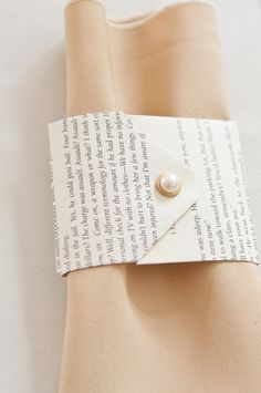 Book page + pearl napkin wraps.
