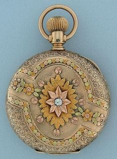 Lovely Illinois multicolor gold antique ladies pendant watch circa The case engraved overall, with designs in four colors of gold, the cover with a diamond. White enamel dial (insignificant hairline) with blued steel hands. Nickel 15 jewel m Antique Watches, Antique Clocks, Vintage Watches, Old Pocket Watches, Pocket Watch Antique, Antique Jewelry, Vintage Jewelry, Bijoux Art Deco, Beautiful Watches