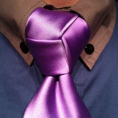 Tired of the Windsor? The stop tying it! It is not the only knot available. The Trinity is about the same size, has three-way symmetry, and looks good on any kind of tie.