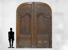 Important and rare door from an Haussmannian building in oakwood, late century (Reference - Available at Gallery Marc Maison Porte Cochere, Walnut Doors, Oak Doors, Architectural Antiques, Architectural Elements, Baron Haussmann, Saint Ouen, Wrought Iron Gates, Napoleon Iii