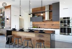 White wood kitchen backsplash a modern space with an industrial feel and warm colored wood on . White Wood Kitchens, Wooden Kitchen, New Kitchen, Kitchen Interior, Cool Kitchens, Kitchen Decor, Kitchen Ideas, Kitchen Modern, Kitchen White
