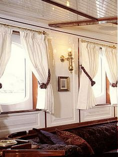 Brass curtain rods and white short curtains. Could do this on my pool windows?