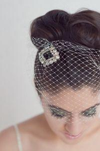 Rhinestone vintage brooch atop birdcage veil
