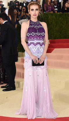 EMMA ROBERTS in a violet-to-shell-pink ombré Tory Burch halter gown, Edie Parker clutch and Norman Silverman diamonds. Met Gala 2016