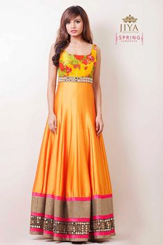 A tangerine full length silk suit with yellow printed spring symphony yoke. Embroidered with a mirror and sequin border at the hem with hints of pink. Doubles up as a gown for evening affairs.