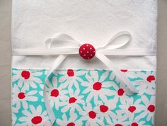 Kitchen towels with red and aqua daisies by SeamlessExpressions