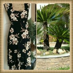 My little island doll black and tan floral dress So fun and carefree is this cute island inspired easy wear dress. Pull over style. Delicate ruffles at the neckline and sleeve hems. Gathering at the bodice. Empire waist that ties in the back. Beautiful cond. Polyester spandex blend. Axcess Dresses