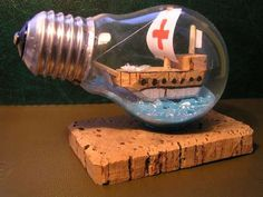 Ships in a bottle are sooo last year, tiny ships in a recycled light bulb.... now we're talkin'