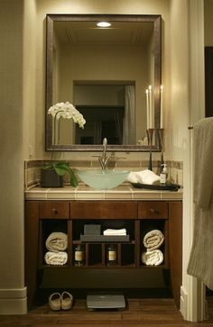 Small Bathroom: Vanity with open shelving