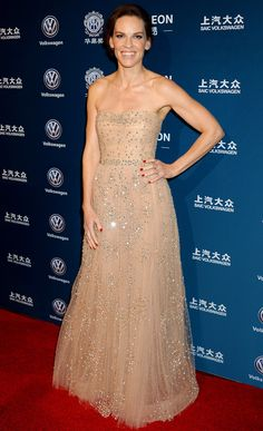 HILARY SWANK wearing an embellished nude strapless tulle gown by Carolina Herrera at the 21st Annual Huading Global Film Awards.
