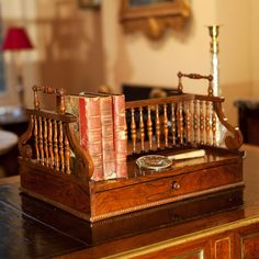 Seriously coveting one of these...A 19th century rosewood desk / library book stand with spindle turned divisions, and a single long drawer.