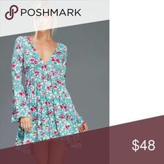 NWT Retail! Blue Floral Dress Fun, Flirty and Floral! Blue floral dress with long bell sleeves. V-neck neckline. Dresses
