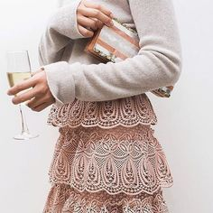 Soft pink layers: a delicate knit top tucked into a lace crochet skirt