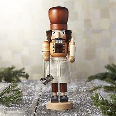 Hand carved of solid wood and carefully hand-assembled piece by piece, this traditional holiday character suits up in an apron, holding a rolling pin and cookie cutters. Beautifully detailed and expertly crafted, each figure is coiffed and bearded in faux fur.