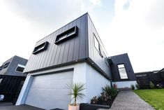 An affordable, architecturally designed home stands out from the crowd with James Hardie Stria Cladding Exterior Wall Design, Exterior Wall Cladding, Best Exterior Paint, House Cladding, Exterior Paint Colors For House, Exterior Siding, Facade House, Metal Cladding, House Facades