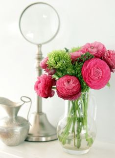 floral dresser top floral arrangement with silver accessories
