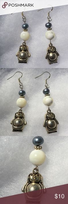 Black and White Freshwater Pearl Penguin Earrings These cute earrings are made with natural black freshwater pearls and mother of pearl beads. The hooks are sterling silver.   All PeaceFrog jewelry items are handmade by me! Take a look through my boutique for more unique creations. PeaceFrog Jewelry Earrings