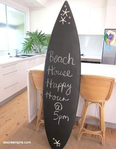 Chalk it up to a day at the beach. Old surfboard or template+chalkboard paint= Super rad idea.
