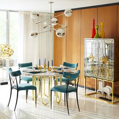 Elegant entertaining. Dine luxe with our new Scalinatella Dining Table - your choice of a Marble, Pickled Oak, Burnt Oak, or White Lacquer Top - with sinuous brass base. Pair it with our Delphine Bar and Riding Dining Chairs and watch the glamour unfold.