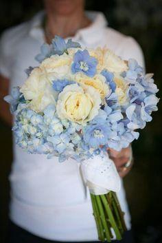 Blue and white wedding bouquet. Designed with blue hydrangea, light blue delphinium blossoms, and fragrant white garden roses. Backyard Garden Florist.