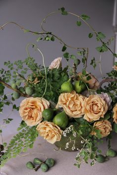 Wild vine, rose an fruit wedding centerpiece by Sarah Winward.