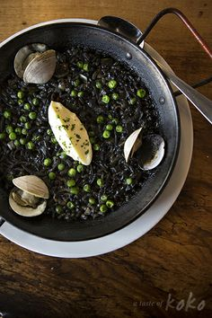 Black rice in a sepia squid ink broth, with squid, clams, fish, and peas at Barlata in Austin, TX