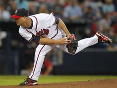 """Tim Hudson """"finishing"""" this pitch in the proper way. Nose in the mitt and getting good extension through his front foot. Braves Baseball, Baseball Cards, Arcade, Tim Hudson, Atlanta Braves, Music Love, Pitch, Husband, Sporty"""