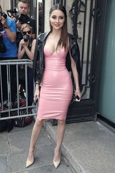 Pink latex cleavage-baring dress worn with black leather jacket draped over shoulders.. DIY the look yourself: http://mjtrends.com/pins.php?name=pink-latex-sheeting-for-dress