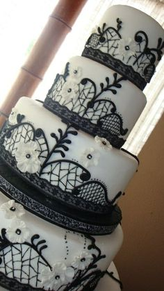 Black and white wedding cake -- love the real lace borders