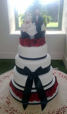 Ivory, Black & Red Wedding Cake minus the people on top this is GORGEOUS!!!