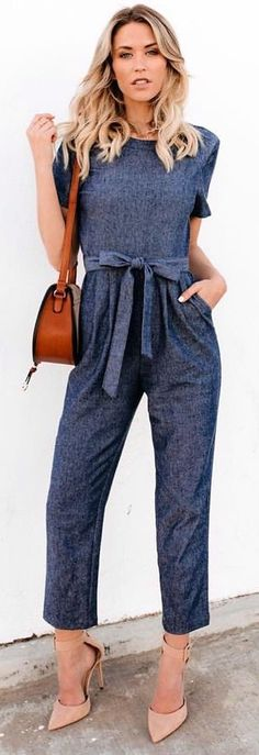 #spring #outfits woman wearing gray short-sleeved overalls standing in front of white painted wall. Pic by @vicidolls