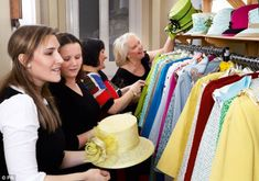 Matching: Angela Kelly and her team pick out a hat with matching coat for Queen Elizabeth II