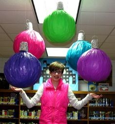 $1 store beach balls covered with plastic tablecloths and topped with solo cups covered with foil. The rings at the top are paper clips.