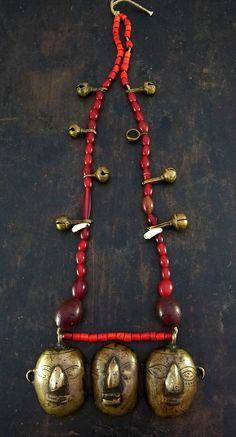 India | Old Naga tribe head hunters necklace; old Venetian white hearts, carnelian, shell and glass beads are combined with brass bells and central brass pendant