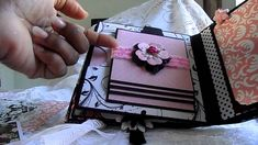 black, white pink mini album.........lots of ideas for pages incorporating almost every type of album insert. Lovely!