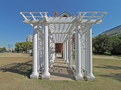 Pergola leading from the main house to the little Tea House on the far left-hand side of the lawn (when viewing the lawn from the front door).  This view of the portico is from the Tea House to the main house.