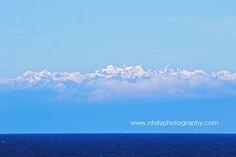 entre ciel et mer montagnes neige nuages