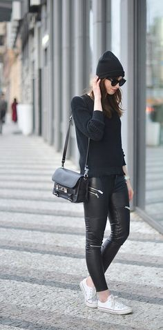 Dress all in black with leather leggings and white Converse sneakers: | 29 Looks For Women Who Don't Want To Wear Heels