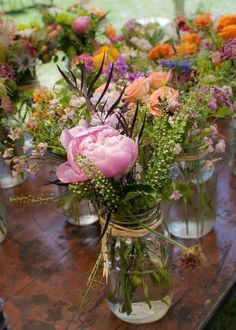 Beautiful flowers in #masonjars - one of our favorite looks of all time {Flowers & Design}