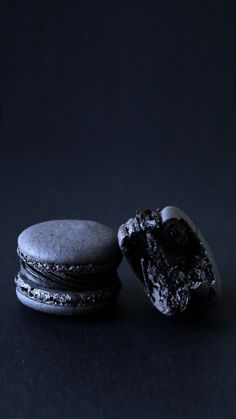 Food photography styling | Dark and moody photos | Black Truffle Macarons! Black is the new black when it comes to this delish dessert with a chocolate truffle center.
