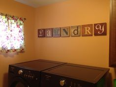 Just completed my laundry room decor. Letters from Hobby Lobby.