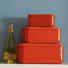 rectangular biscuit tins...to hide all of Chris' coffee stuff on the counter. They actually are bright orange in real life!