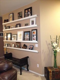 Picture frame collage.  easier and cheaper.  dollar tree frames painted white or black.  IKEA shelf?