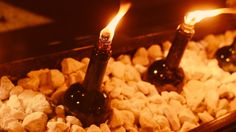 Keep the bugs at bay with wine bottle citronella torches. You could even nestle them in sand and stones for a pretty fire feature. Old Wine Bottles, Recycled Glass Bottles, Wine Craft, Wine Bottle Crafts, Café Exterior, Tiki Torches, Citronella Torches, Citronella Candles, Wine Bottle Tiki Torch