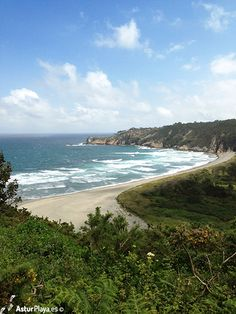 Barayo beach surrounded by cliffs and lush vegetation. A protected Natural Area in Asturias, Spain.