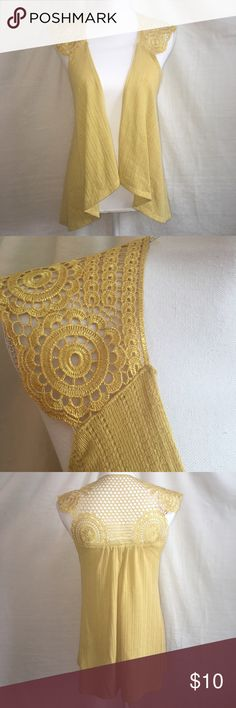 ♦️ Almost Famous High-Low Vest Pretty vest in a yellow/gold color with crochet accent. Cotton/polyester blend. In like new condition. Almost Famous Tops