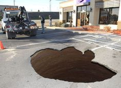 02/13/2017 - Three tow trucks were used to keep an unoccupied Oldsmobile Alero from falling into a sinkhole in the Taco Bell parking lot near the intersection of U.S. 421 West and Winkler Mill Road in Wilkesboro, NC about 8 a.m. Monday.