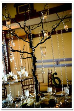 centerpieces for weddings | ... tree branch for a creative centerpiece // Photo by Mulberry Photo