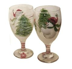 ArtisanStreet's Set of 2 Snowman Design Glasses. Hand Painted, Made to Order, Signed by ArtisanStreet. $50.00. Glasses measure 7 inches tall. Wash with mild soap and water. Great housewarming gift, or buy for yourself. Individually hand painted & made to order & signed by artisan. Snowman design features snowmen, fir trees & candy canes. Set of 2 glasses features a winter scene with snowmen, fir trees and candy canes. Perfect for serving eggnog, lemonade or your ...